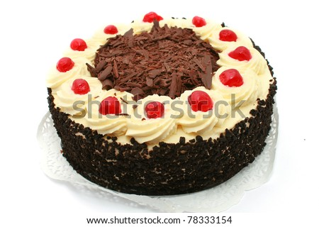 Black forest cake, topped with whipped cream and cherry isolated on white