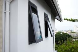 Black frame aluminium windows of building.