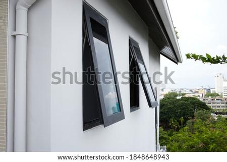 Black frame aluminium windows of building. Stockfoto ©