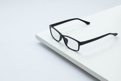 Black frame glasses isolated on  white background. white board