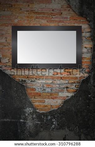 black frame on the Old grunge brick wall. text box. art