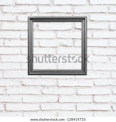 black frame on white brick wall