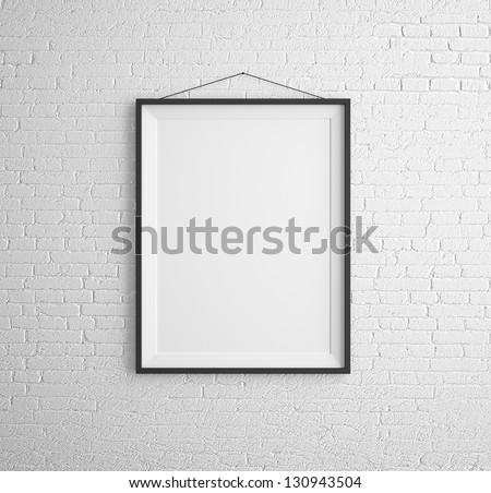 black frames on brick wall