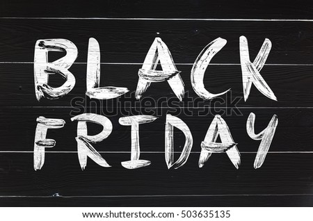black friday brush hand lettering on white painted rustic barn wooden planks greeting card or