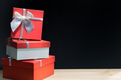 Black Friday, Christmas and New Year's Gift.Stack of red gift box on black background.
