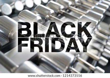 Black friday poster. Rows of dumbbells in the gym with high contrast light #1214373556