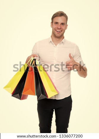 794f499f29670 Black friday sale concept. Man formal clothes carry shopping bags. Guy happy  carry bunch · young caucasian man wearing santa hat for christmas ...