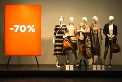 Black Friday sale. Female mannequins near the red stand