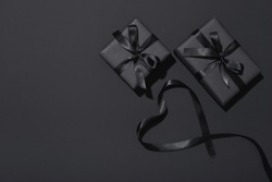 Black Friday sale flat lay with presents and ribbon in heart shape