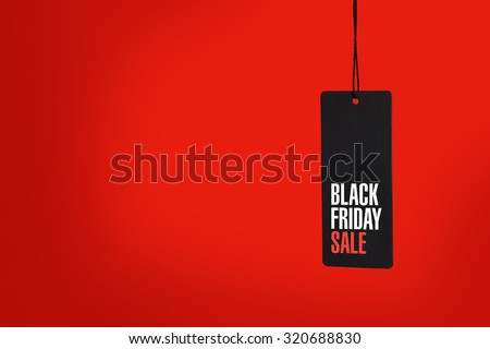 Black friday. Sale tag on the red background #320688830