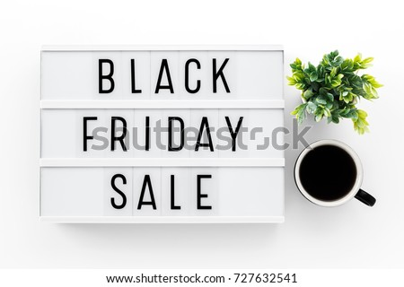 Black friday sale word on lightbox on white table