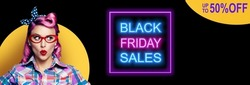 Black Friday Sales, discounts, rebates, trade deals concept - excited surprised pin up woman in red glasses looking sideways. Purple girl in pinup rockabilly style. Neon light sign. 50% off text. Wide