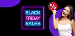 Black Friday Sales, discounts, rebates, trade deals concept - happy gesturing woman with wide open mouth raising hand up. Excited girl holding red circus % procents save sign board.