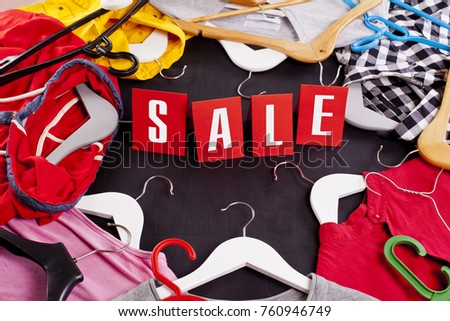 Black Friday shopping sale concept with red Sale tag and clothes