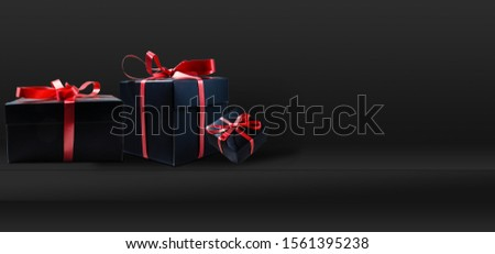 Black Friday Super Sale. Shelf and podium with realistic black gifts boxes with gold bows. Dark background golden text lettering. Horizontal banner, poster, header website #1561395238
