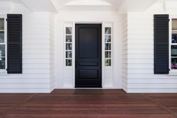 Black front door of classic style home in Oregon.
