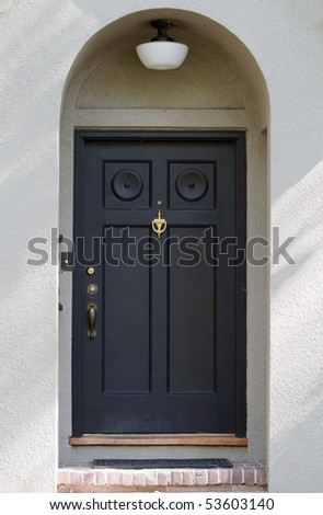 Black Front Door on Black Front Door On Tan Stucco House Stock Photo 53603140