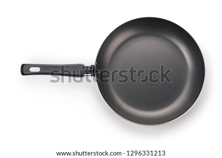 Photo of  Black frying pan top view. Isolated on white, clipping path included
