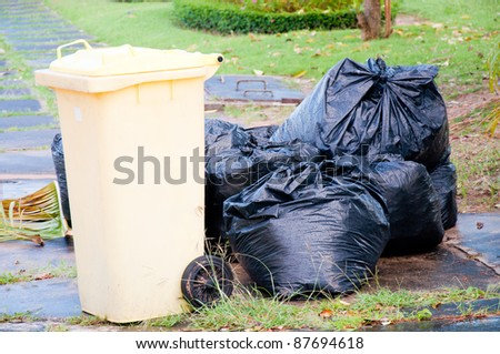 black garbage bag and bin
