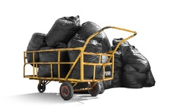 Black garbage bags stack on trash pushcart isolated on white background with clipping path, environment concept