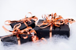 Black gift box. Black Friday abstract photo. Shopping and sales composition.