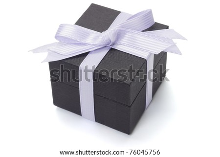 Black gift box with bow ribbon on white background