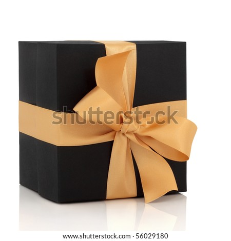 Black gift box with gold satin ribbon and large bow, isolated over white background with reflection.