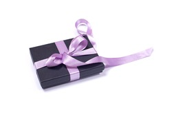 Black gift box with purple ribbon and ribbons on a white background