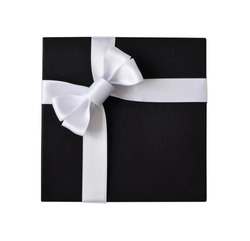 Black gift box with white ribbon isolated on white background, top view