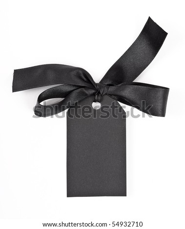 Black gift tag tied with a bow of red satin ribbon