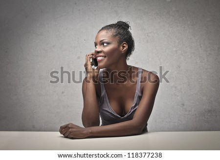 Black girl calling with a mobile phone