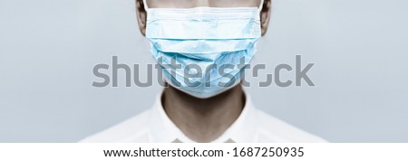 Black girl Doctor wearing protection face mask against covid-19. Banner panorama medical staff preventive gear about coronavirus. Woman in medical mask stops 2019-nCov Stock fotó ©