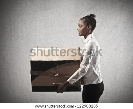 Black girl holding a box