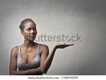 Black Girl mimicking to hold something