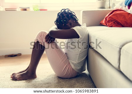 Black girl with sadness emotion