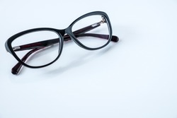 black glasses on white table