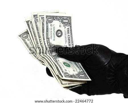 black gloved hand holding american money in dollar bills isolated on white