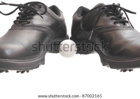 Black golf shoes with a ball in the middle isolated on white