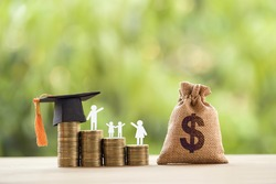 Black graduation cap, hat, student and kid, rows of rising coins, white clock on a table, natural green background. Public school funding, education funding, financial concept