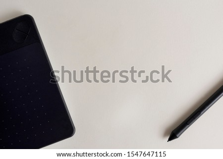 Black graphic tablet with pen for illustrators and designers. Graphic digital touch tablet with White background and stylus pen #1547647115