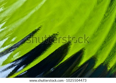 Black green texture of a hazy glass bottle
