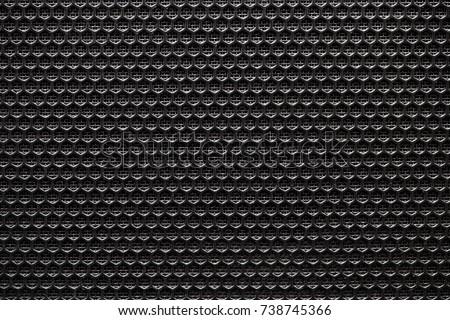Black grid of audio amplifier texture.