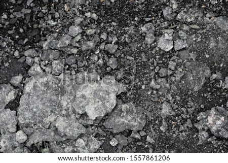 Black ground textured ground. Black soil as a backgdround or texture