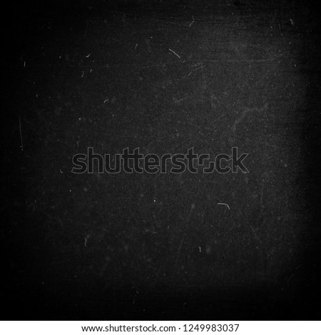 Black grunge scratched background, distressed texture, old film effect #1249983037