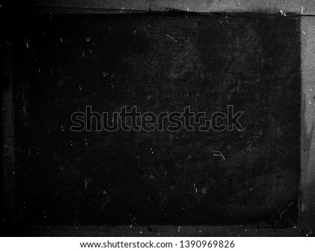 Black grunge scratched background, old film effect, obsolete dusty scary horror texture with frame #1390969826