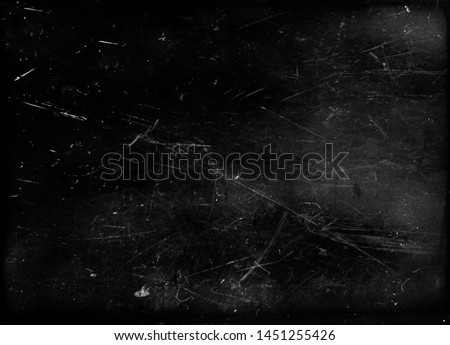 Photo of  Black grunge scratched metal background, scary distressed horror texture