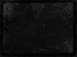 Black grunge scratched texture with frame, old film effect, perfect background for halloween concept, space for your text or picture