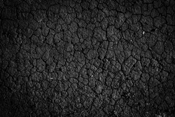 Black grungy cracked earth ground texture background