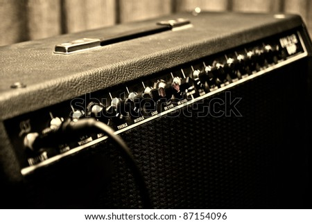 black guitar amplifier with switches and knobs