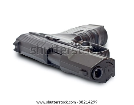 Black gun lying on a white background